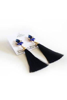 Aretes con borlas azules y cristal de acrílico tipo flor.