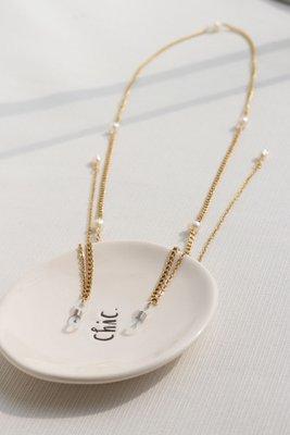 Accesorio para lentes de acero con perlas.