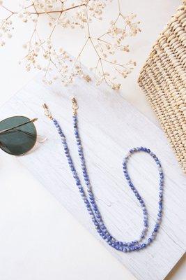 Descripción: Sujetador de lentes con piedras naturales.  Material: Accesorios de acero
