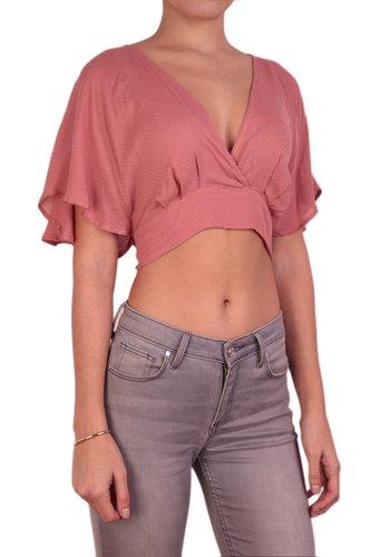 Blusa crop con amarrado en espalda.