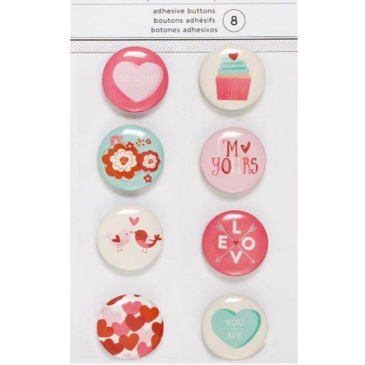 Aplicaciones adhesivas en forma de botones , pefectos para todos tus proyectos de tarjeteria, cartonaje, älbumes y otras manualidades.
